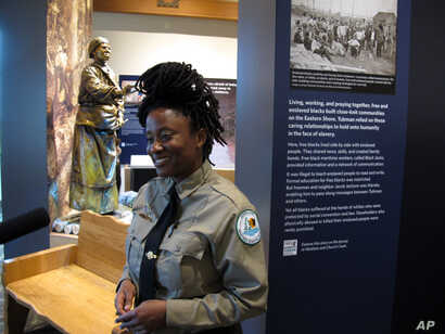 Angela Crenshaw, assistant manager of Harriet Tubman Underground Railroad State Park, talks about exhibits in the new visitor's center during a media preview, March 10, 2017 in Church Creek, Maryland.