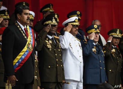 Venezuelan President Nicolas Maduro, left, and members of the military high command attend a military honor ceremony in Caracas on May 24, 2018.