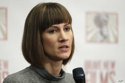 Rachel Crooks speaks at a news conference, Monday, Dec. 11, 2017, in New York to discuss her accusations of sexual misconduct against Donald Trump.