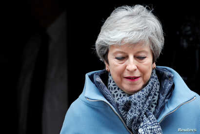 Britain's Prime Minister Theresa May leaves 10 Downing Street, as she faces a vote on alternative Brexit options, in London, Britain, March 27, 2019.