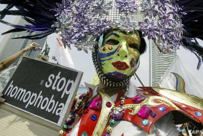 Gay rights activists demonstrate on the International Day Against Homophobia in Jakarta, Indonesia, May 17, 2008.