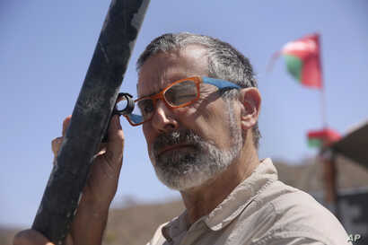 Peter Kelemen, head of the Oman Drilling Project, checks a fresh rock core sample during a geological research project in the al-Hajjar mountains of Oman, March 1, 2017.