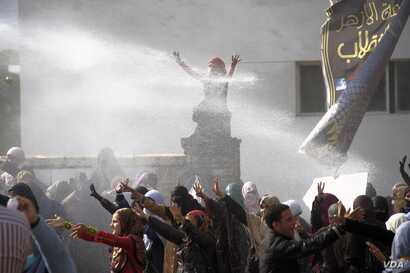 Water cannon are fired on female Islamist students during a protest at Al-Azhar University in Cairo, Dec. 11, 2013. (Hamada Elrasam for VOA)