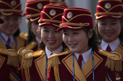 Members of the North Korea cheering group gather before a welcome ceremony inside the Gangneung Olympic Village prior to the 2018 Winter Olympics in Gangneung, South Korea, Thursday, Feb. 8, 2018. Members of the North Korea cheering group gather befo...