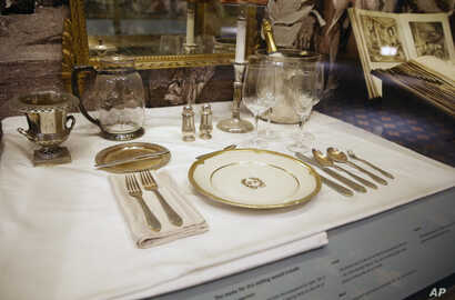 A place setting is displayed behind glass in the small museum off the lobby of New York's renowned Waldorf Astoria, Feb. 28, 2017. The newest version of the hotel opened on Park Avenue in 1931, built at a cost topping $40 million ($639 million in tod...