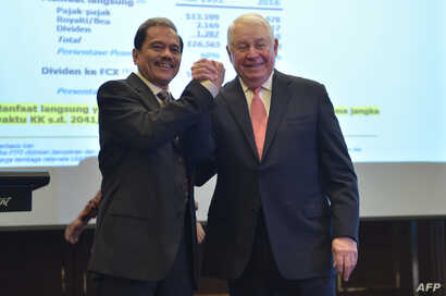 FILE - Richard C. Adkerson (R) Director President and Chief Executive Officer (CEO) of Freeport-McMoran Inc and former CEO of PT. Freeport Indonesia Chappy Hakim (L) pose for photographers after a press conference in Jakarta, Feb. 20, 2017.US mining ...