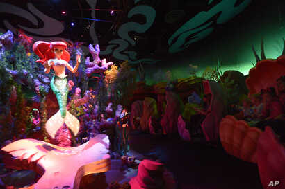 FILE - Tourists experience the Under the Sea — Journey of the Little Mermaid ride at the Walt Disney World Resort's Magic Kingdom theme park in Lake Buena Vista, Fla., Dec. 6, 2012.