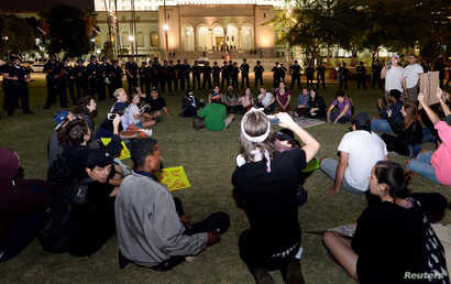 Protesters are surrounded by Los Angeles police before they were detained in Grand Park across Los Angeles City Hall after a march and rally against the election of Republican Donald Trump as president of the United States, Nov. 12, 2016.