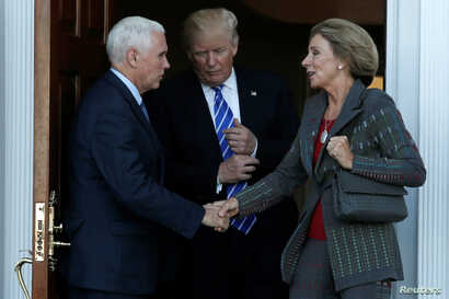 U.S. President-elect Donald Trump and Vice President-elect Mike Pence emerge with Betsy DeVos after their meeting at the main clubhouse at Trump National Golf Club in Bedminster, N.J. Nov. 19, 2016.