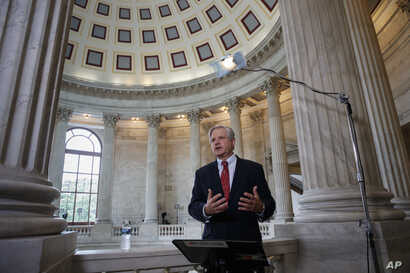 FILE - Senator John Hoeven, R-N.D., responds to questions during a TV news interview on Capitol Hill in Washington, July 11, 2017.