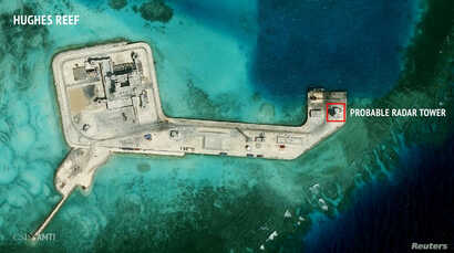 FILE - A satellite image released by the Asian Maritime Transparency Initiative at Washington's Center for Strategic and International Studies shows construction of possible radar tower facilities in the Spratly Islands in the disputed South China Se...