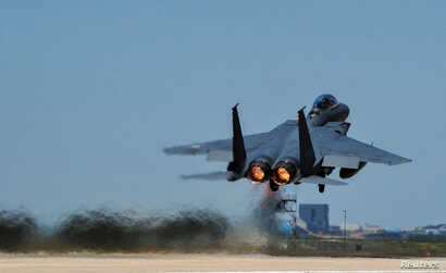 FILE - A Republic of Korea Air Force F-15K Slam Eagles fighter plane takes off during Exercise Max Thunder 17 at Gunsan Air Base, South Korea, April 27, 2017.