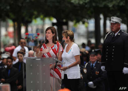 People read the names of the victims during a commemoration ceremony for the victims of the September 11 terrorist attacks at the National September 11 Memorial and Museum in New York City, Sept. 11. 2016.
