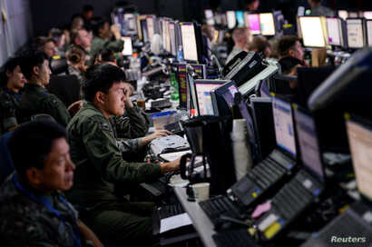 FILE - Members from U.S. and South Korean militaries man the Hardened Theater Air Control Center during the first day of Ulchi Freedom Guardian at Osan Air Base, South Korea, Aug. 17, 2015