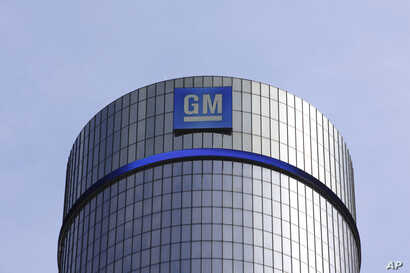 FILE - The General Motors headquarters building is seen in Detroit, Michigan, May 5, 2011. On Tuesday, President-elect Donald Trump criticized the largest U.S. automaker for sending its Mexican-made Chevrolet Cruze compact models back to U.S. car dea