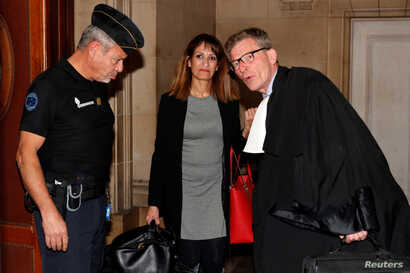 Nathalie Haddadi, who sent money to her radicalised son who fought in Syria, arrives at court with her lawyer, Paris, France, Sept. 28, 2017.
