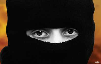 """A masked youth is seen in an image from """"Strashnaya Skazka Daesh"""" (""""Daesh Horror Story""""), a Russian brochure that aims to """"unmask IS recruitment strategies."""""""
