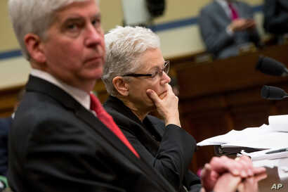 Michigan Gov. Rick Snyder and EPA Administrator Gina McCarthy appear before a House Oversight and Government Reform Committee hearing in Washington, March 17, 2016.