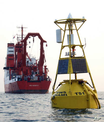 FILE- A buoy, which is a part of a tsunami warning system developed by GITEWS (German-Indonesian Contribution for the Installation of a Tsunami Warning System), floats in on the sea off Java island, Indonesia, Nov. 15, 2005.