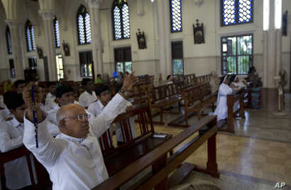 A priest offers prayers with others at the Immaculate Heart of Mary Cathedral in Kottayam in southern Indian state of Kerala, Nov. 4, 2018.