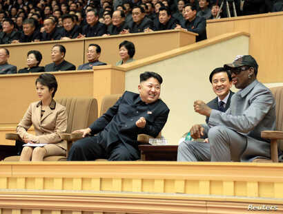 North Korean leader Kim Jong Un (2nd L) watches a basketball game between former U.S. NBA basketball players and North Korean players of the Hwaebul team of the DPRK with Dennis Rodman (R) at Pyongyang Indoor Stadium in this undated photo released by...