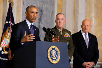 U.S. President Barack Obama delivers a statement accompanied by Director of National Intelligence James Clapper, right, and Chairman of the Joint Chiefs of Staff General Joseph Dunford after a meeting with Obama's national security team at the Treasu...