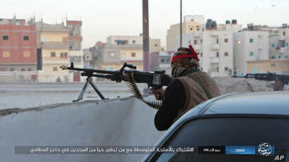 This photo posted on a file sharing website Wednesday, Jan. 11, 2017, by the so-called Islamic State Group in Sinai, a militant organization, shows a deadly attack by militants on an Egyptian police checkpoint,  Monday, Jan. 9, 2017, in el-Arish, nor...