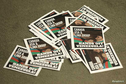 Leaflets thrown by protesters are seen during the closing news conference at the Lima Group meeting in Ottawa, Ontario, Canada, Feb. 4, 2019.