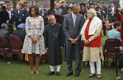 U.S. President Barack Obama, second right and first lady Michelle Obama, left stand with Indian Prime Minister Narendra Modi, right and Indian President Pranab Mukherjee during a photo op at a reception hosted by Mukherjee on India's Republic Day a...