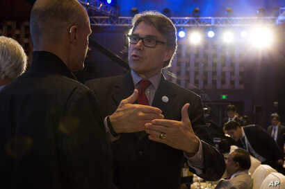 FILE - U.S. Energy Secretary Rick Perry attends the opening ceremony of an international clean energy conference held in Beijing, China, June 7, 2017.