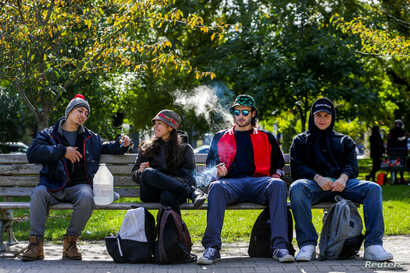 People smoke on the day Canada legalizes recreational marijuana at Trinity Bellwoods Park, in Toronto, Ontario, Canada, Oct. 17, 2018.