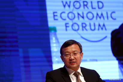 Chinese Vice Minister of Commerce Wang Shouwen speaks during the Business Forum at the 11th World Trade Organization's ministerial conference in Buenos Aires, Argentina. Dec. 12, 2017.
