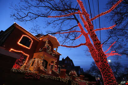 A house and tree are decorated for Christmas in the Brooklyn neighborhood of Dyker Heights, New York, Dec. 14, 2016.