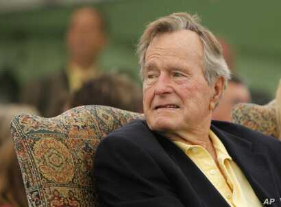 Former President George H.W. Bush attends a ceremony to unveil a new garden named in his wife's honor, Sept 29, 2011, in Kennebunkport, Maine.
