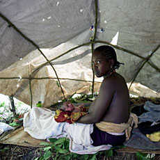 A woman who gave birth while fleeing from attacks by the Lord's Resistance Army (LRA) in the region sits in a makeshift tent near the south-western Southern Sudan town of Yambio (File)