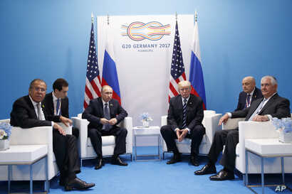 President Donald Trump meets with Russian President Vladimir Putin at the G-20 Summit in Hamburg, July 7, 2017. Russian Foreign Minister Sergey Lavrov is at left, Secretary of State Rex Tillerson is at right.