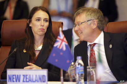New Zealand Trade and Export Growth Minister David Parker talks with his country's prime minister, Jacinda Ardern, at a Trans-Pacific Partnership meeting in Danang, Vietnam, Nov. 10, 2017.