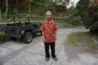Asih has been the juru kunci, or spiritual caretaker, of Mount Merapi since 2011.  (K. Varagur for VOA)