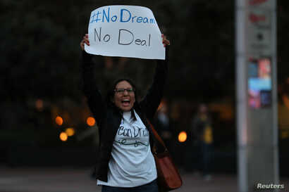 A small group of demonstrators block traffic to demand action by the federal government on the Deferred Action for Childhood Arrivals (DACA) in downtown San Diego, California, Dec. 4, 2017.