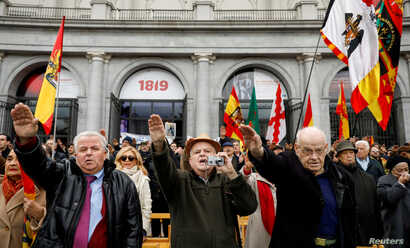 Supporters of Spain's late dictator Francisco Franco give fascist salutes during a gathering commemorating the anniversary of Franco's death at Madrid's Plaza de Oriente, Spain, November 18, 2018.