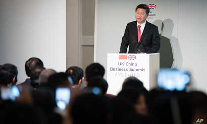 "FILE - China's President Xi Jinping addresses guests and delegates at the UK-China Business Summit in Mansion House, central London, Oct. 21, 2015. Britain will be China's ""partner of choice"" in the West, Prime Minister David Cameron declared as part..."