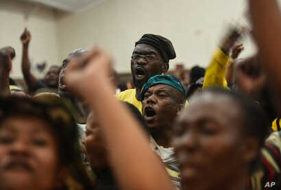 Angry residents shout after refusing to accept the replacement of Pretoria's mayoral candidate at a community center in Atteridgeville, Pretoria, South Africa, June 21, 2016.