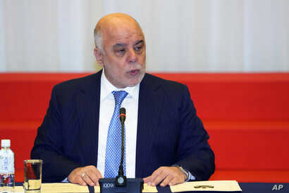 FILE - Iraq's Prime Minister Haider al-Abadi delivers a speech at the opening ceremony of the expert level of the international conference on Iraqi economic development in Tokyo, Thursday, April 5, 2018.
