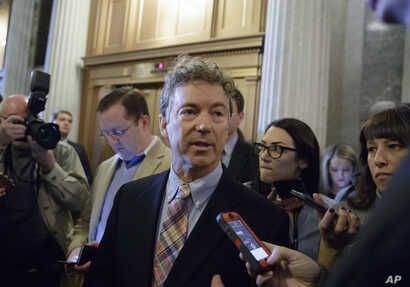 Sen. Rand Paul, R-Ky., is pursued by reporters on Capitol Hill in Washington, April 7, 2017.