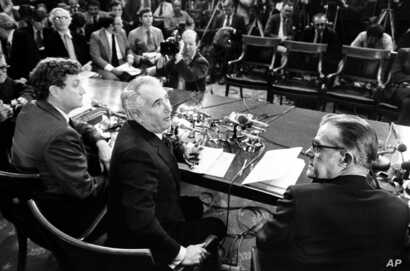 Chairman Peter Rodino, D-N.J., of the U.S. House of Representatives Judiciary Committee,center, chief counsel John Doar, left, and minority counsel Albert Jenner, right, gather for a news conference in Washington,  March 5, 1974.  Doar presented a st