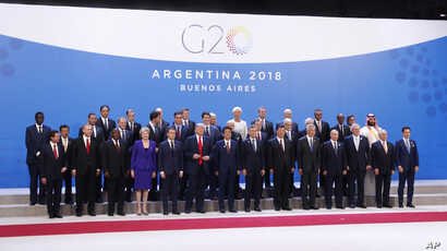 World leaders participate in a family photo at the G-20 summit, Nov. 30, 2018 in Buenos Aires, Argentina.