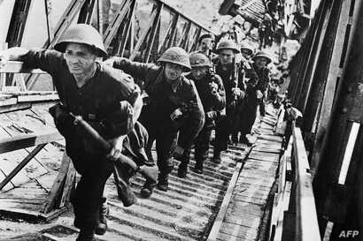 FILE - British soldiers of Allied forces are seen during D-Day landing operations in Normandy, France, early June, 1944.