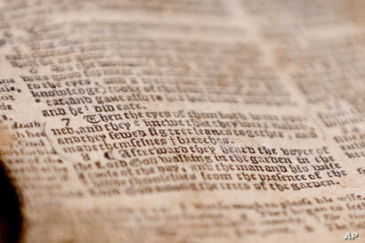 """The word """"breeches"""" is visible as the last word in verse 7 of chapter 3 in Genesis in the theft recovered Bible shown during a news conference, April 25, 2019, in Pittsburgh. The word gives the 1615 Breeches Edition Bible in the 1990's its name."""