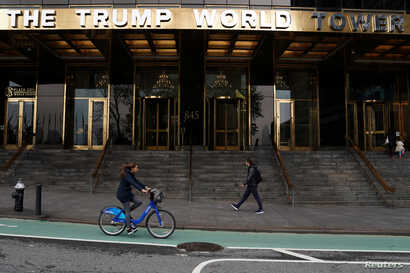 People pass the Trump World Tower in the Manhattan borough of New York, April 30, 2019.