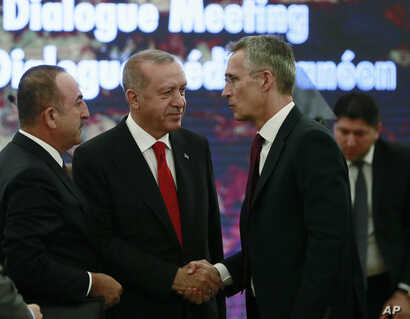 Turkey's President Recep Tayyip Erdogan, center, and Foreign Minister Mevlut Cavusoglu, left, speak with NATO Secretary General Jens Stoltenberg during a NATO's Mediterranean Dialogue, in Ankara, Turkey, Monday, May 6, 2019.